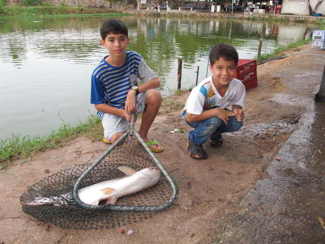 My sons having fun at a Pattaya fishing park