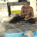 Thai Fisherman Repairing Nets