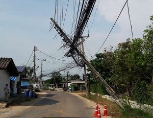 Leaning overhead power cable pole in Pattaya Thailand