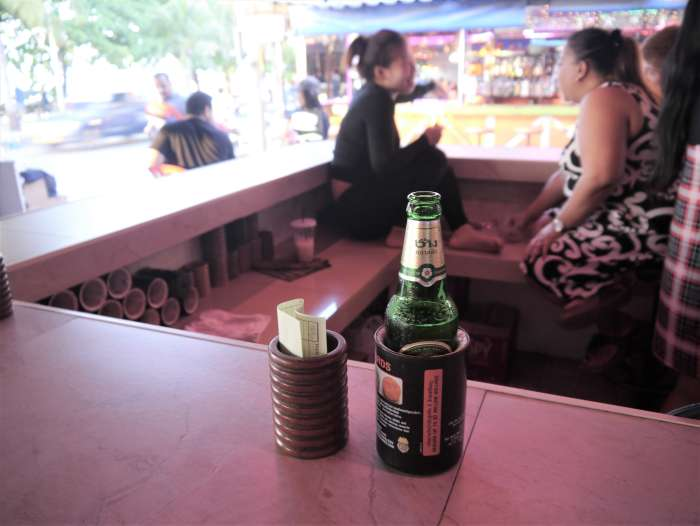 beer in cooler (condom) and check bin, Thailand
